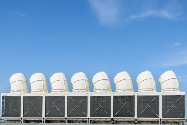 Industrial cooling towers or air cooled chillers on building rooftop